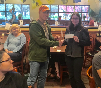 Les Imboden cuts a check to Emily Geest.